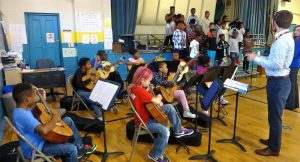The Classical Guitar Society with students